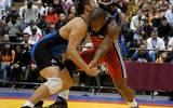 En la imagen, Odelis Herrero (de rojo) en un combate por la Medalla de Bronce de 74KG en el Campeonato Panamericano de Luchas 2008 ante Juan Escobar de México (2008) /Archivo: @Mexwrestling01